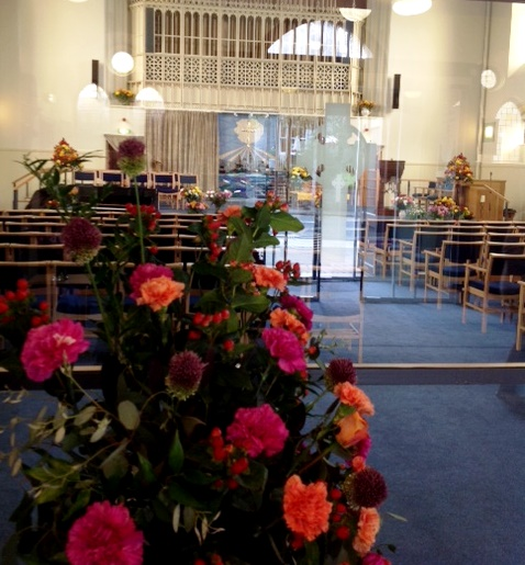 Photo of flowers in the Sanctuary at harvest time.