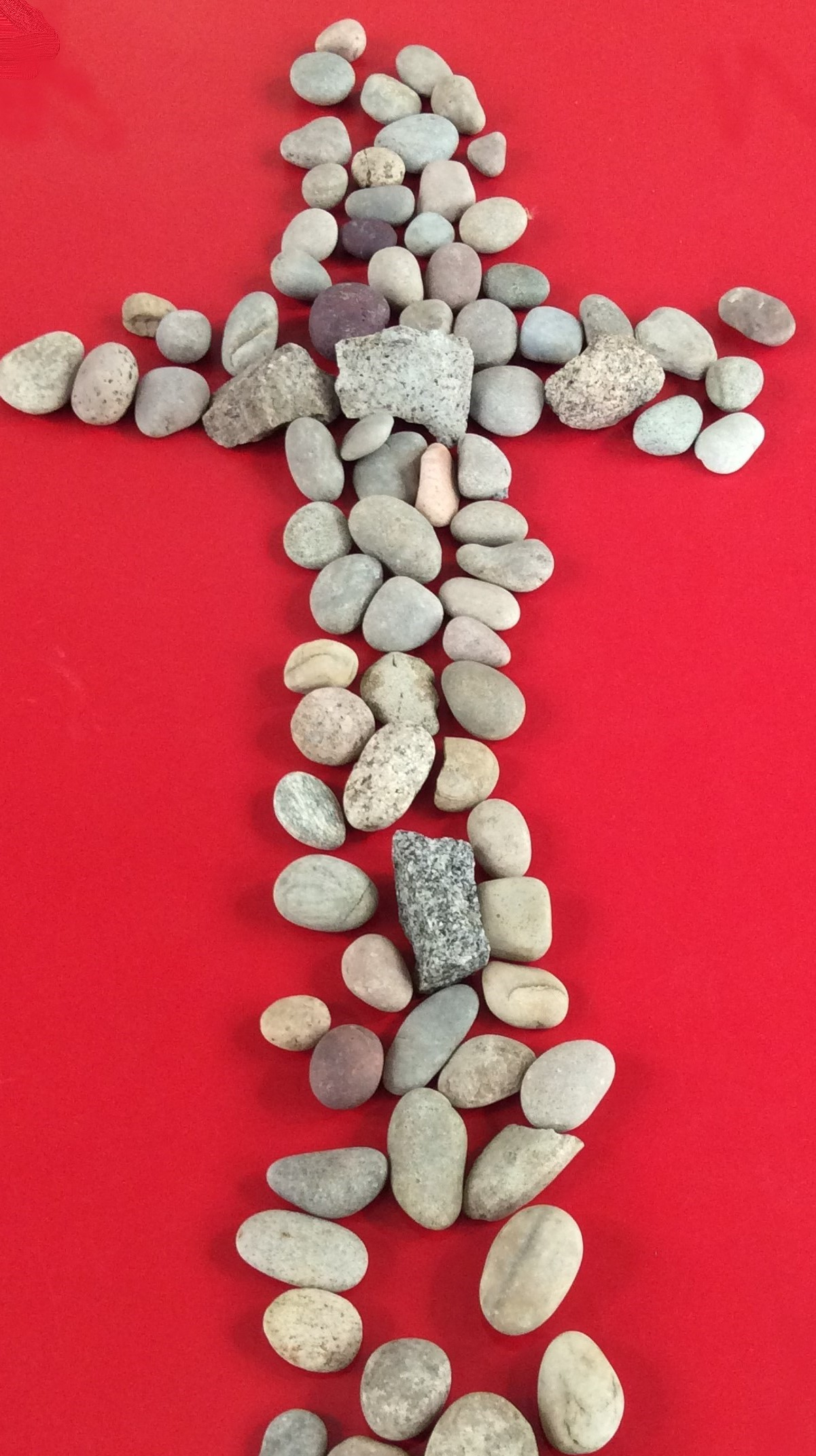 Photo of a cross made of stones