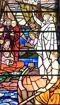 Photo showing part of the stained glass window with Jesus preaching from the boat.